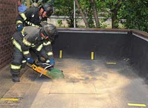 Photo FDNYFirefighters demonstrate how firefighters from across the city will use the Roof Operations Training Simulator.