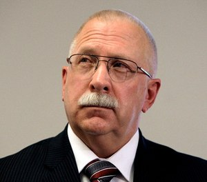 This Aug. 19, 2010, file photo shows Arizona Department of Corrections Director Charles Ryan at a news conference in Phoenix. Ryan is blaming a medical services contractor for a failure to follow through on promises to improve health care for inmates when the state settled a lawsuit over inmate care. (AP Photo/Ross D. Franklin, File)