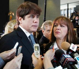 In this Dec. 7, 2011 file photo, former Illinois Gov. Rod Blagojevich, left, speaks to reporters as his wife, Patti, listens at the federal building in Chicago. (AP Photo/M. Spencer Green, File)