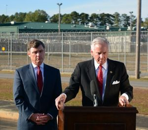 South Carolina Corrections Director Bryan Stirling, left, and Gov. Henry McMaster stand outside the state's death row at Broad River Correctional Institution in Columbia, S.C. (AP Photo/Meg Kinnard)