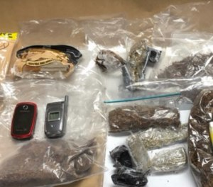 Officials said the women were attempting to smuggle in contraband that contained tobacco, marijuana, cellphones and a pill that tested positive for ecstasy (Photo/KFOR)