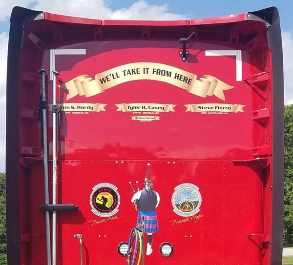 The names of fallen firefighters are emblazoned on the back of the Memorial Run truck. (Photo/Randall Rogers)