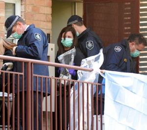 Australian Federal Police search an apartment in Melbourne, Australia, Friday, June 9, 2017. Australian police on Friday raided homes in Melbourne and took three men into custody as part of their investigation into a siege earlier this week in which a gunman killed an apartment building receptionist and wounded police officers, officials said. (Mal Fairclough/AAP Image via AP)