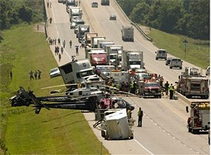 AP Photo/Gary CrowRescue workers and authorities work at the scene.