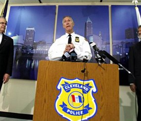 Cleveland Police Chief Michael McGrath, center, announces the results of disciplinary hearings for officers involved in a deadly chase on Oct. 15. (AP Image)