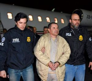 """In this Jan. 19, 2017, file photo provided U.S. law enforcement, authorities escort Joaquin """"El Chapo"""" Guzman, center, from a plane to a waiting caravan of SUVs at Long Island MacArthur Airport, in Ronkonkoma, N.Y. (U.S. law enforcement via AP, File)"""
