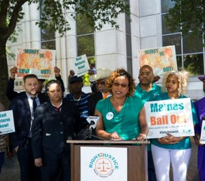 This photo taken May 4, 2017, shows Criminal Justice Campaign Director Tarsha Jackson speaking about the bail lawsuit during a press conference outside the Harris County Criminal Justice Center in Houston. (Godofredo A. Vasquez/Houston Chronicle via AP)