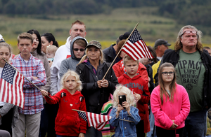 Audience members attend the September 11th Flight 93 Memorial Service, Tuesday, Sept. 11, 2018, in Shanksville, Pa. President Donald Trump is marking 17 years since the worst terrorist attack on U.S. soil by visiting the Pennsylvania field that became a Sept. 11 memorial. (AP Photo/Evan Vucci)