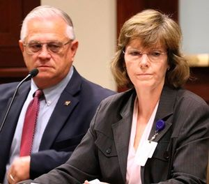 In a Wednesday, Oct. 11, 2017 file photo, Arkansas Department of Correction Director Wendy Kelley, right, testifies before legislators at the state Capitol complex in Little Rock with deputy director Dale Reed at her side. (AP Photo/Kelly P. Kissel, File)