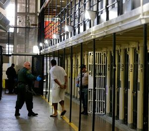 In this Aug. 16, 2016, file photo a condemned inmate is led out of his east block cell on death row at San Quentin State Prison, in San Quentin, Calif. (AP Photo/Eric Risberg, File)