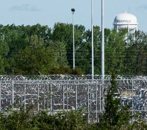 A fence surrounds the Lee Correctional Institution on Monday, April 16, 2018, in Bishopville, S.C. Multiple inmates were killed and others seriously injured amid fighting between prisoners inside the maximum security prison in South Carolina. (AP Photo/Sean Rayford)