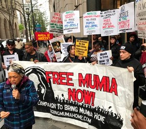 Supporters of Mumia Abu-Jamal, convicted in the 1981 murder of white Philadelphia police Officer Daniel Faulkner, gather outside the Criminal Justice Center in Center City Philadelphia on Monday, April 30, 2018. (Jessica Griffin/The Philadelphia Inquirer via AP)