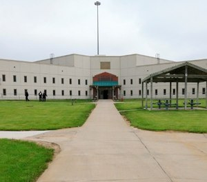 In this May 19, 2015 file photo, a housing unit is seen on the grounds of the Tecumseh State Correctional Institution during a media tour of the facility, in Tecumseh, Neb. (AP Photo/Nati Harnik, File)