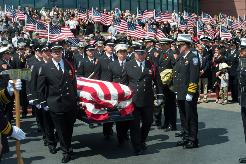 FIn this Aug. 20, 2018, file photo, the casket with fallen Utah firefighter Matthew Burchett is loaded into a fire engine after the funeral at the Maverik Center in West Valley City, Utah. Burchett, a firefighter battling the largest wildfire in California history, was killed last month when thousands of gallons of flame-suppressing liquid were dropped from a Boeing 747 that was mistakenly flying only 100 feet (30 meters) above the treetops, according to an official report Friday, Sept. 14. (Rick Egan/The Salt Lake Tribune via AP, File)