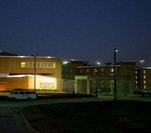 Nightfall descends on Central prison in Raleigh, N.C., Thursday, Dec. 1, 2005. (AP Photo/Gerry Broome)