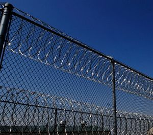 Razor wire lines the fence outside the Tipton Correctional Center March 24, 2007, in Tipton Mo. (AP Photo/L.G. Patterson)