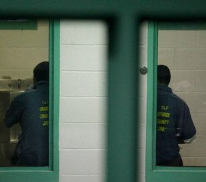 Detainees sit in their cells at the Theo Lacy Facility in Orange, Calif., Tuesday, Sept. 28, 2010. (AP Photo/Jae C. Hong)