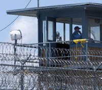 2 Ark. inmates in custody after holding 2 COs hostage