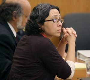 Kimberly Fry watches proceedings her murder trial at Washington County Superior Court in South Kingstown, R.I., Wednesday, Sept. 28, 2011. (AP Photo/Frieda Squires, Pool)