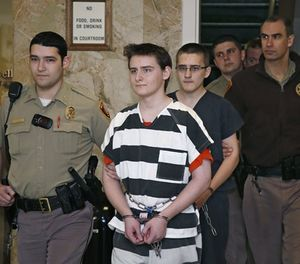 In this Tuesday, Feb. 23, 2016 file photo, two Oklahoma teenage brothers are escorted into a courtroom for a hearing in Tulsa, Okla. (AP Photo/Sue Ogrocki, File)