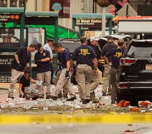 In this Sunday, Sept. 18, 2016 file photo, members of the Federal Bureau of Investigation (FBI) carry on investigations at the scene of Saturday's explosion on West 23rd Street and Sixth Avenue in Manhattan's Chelsea neighborhood, in New York. (AP Photo/Andres Kudacki, File)