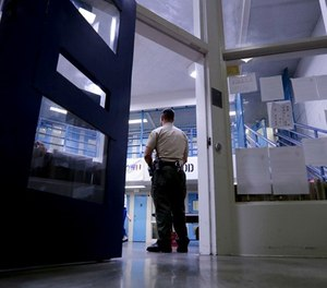 A Sheriff officer stands guard over inmates at the Twin Towers Correctional Facility Thursday, April 27, 2017, in Los Angeles. (AP Photo/Chris Carlson)