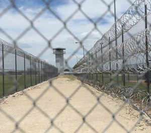This Wednesday, June 21, 2017 photo shows barbed wire surrounding a prison in Gatesville, Texas. (AP Photo/Jaime Dunaway)