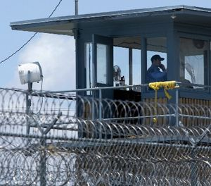In this photo taken May 13, 2011 file photo, a guard is shown in a tower at the Arkansas Department of Correction Tucker Unit near Tucker, Ark. (AP Photo/Danny Johnston, File)