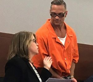 In this Aug. 17, 2017 file photo, Nevada death row inmate Scott Raymond Dozier confers with Lori Teicher, a federal public defender involved in his case, during an appearance in Clark County District Court in Las Vegas. (AP Photo/Ken Ritter, File)