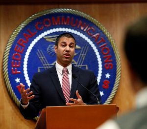 Federal Communications Commission (FCC) Chairman Ajit Pai answers a question from a reporter, Thursday, Dec. 14, 2017, in Washington. (AP Photo/Jacquelyn Martin)