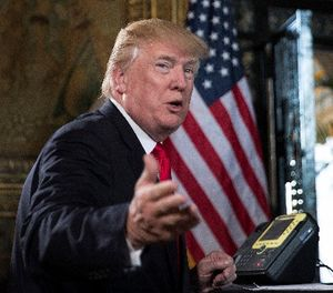 In a Sunday, Dec. 24, 2017 file photo, President Donald Trump turns to talk to the gathered media during a video teleconference in Palm Beach, Fla. (AP Photo/Carolyn Kaster, File)