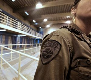 This Aug. 17, 2011 file photo shows a correctional officer in one of the housing units at Pelican Bay State Prison near Crescent City, Calif. (AP Photo/Rich Pedroncelli, File)