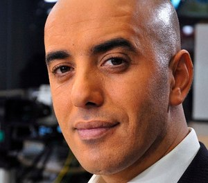 In this photo dated Nov. 22, 2010, notorious French criminal Redoine Faid poses prior to an interview with French all-news TV channel, LCI, as he was promoting his book, in Boulogne-Billancourt, outside Paris, France. (IBO/Sipa via AP)