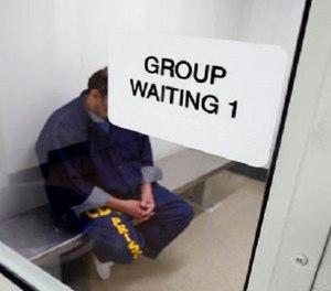 An inmate waits for his appointment in a holding room at a mental health treatment unit at the California Medical Facility in Vacaville, Calif. Gov. (AP Photo/Rich Pedroncelli, File)