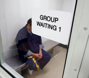 An inmate waits for his appointment in a holding room at a mental health treatment unit. (Rich Pedroncelli, File via AP)