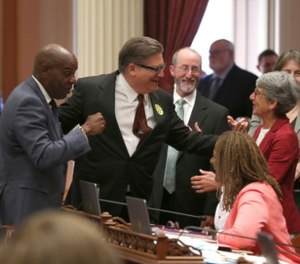 State Sen. Bob Hertzberg, second from left, celebrates with fellow Democratic state Senators after his bail reform bill was passed by the Calif. Senate on Tuesday. (AP Photo/Rich Pedroncelli)