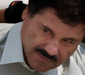 "In this Feb. 22, 2014, file photo, Joaquin ""El Chapo"" Guzman is escorted to a helicopter in handcuffs by Mexican navy marines at a navy hanger in Mexico City. (AP Photo/Eduardo Verdugo,File)"