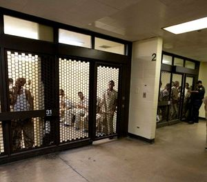 This Sept. 29, 2011 file photo shows inmates at the Cook County Jail in Chicago, the second largest county jail in the nation, waiting to be processed for release. (AP Photo/M. Spencer Green, File)