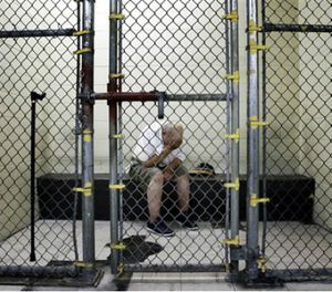 In this June 26, 2014 file photo, a U.S. veteran with post-traumatic stress sits in a segregated holding pen at the Cook County Jail after he was arrested on a narcotics charge in Chicago. (AP Image)