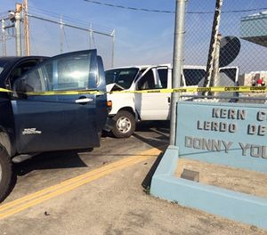 This image shows a pickup truck after a white prison van crashed into it at the gates of the Lerdo Pre-Trial Facility near Bakersfield, Calif., on Wednesday, March 2, 2016. The California Highway Patrol says an inmate crashed the van into a gate during an escape attempt at a Southern California jail. (Ray Pruitt/Kern County Sheriffs via AP)