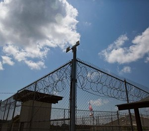In this June 18, 2015, photo, a fence stands at Elmore Correctional Facility in Elmore, Ala. (AP Photo/Brynn Anderson)