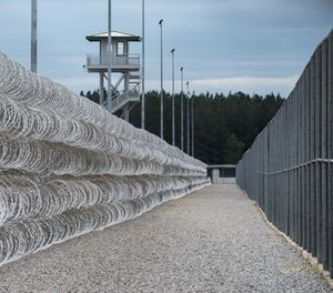 Razor wire protects a perimeter of the Lee Correctional Institution in Bishopville, S.C., Tuesday, Feb. 9, 2016. (AP Photo/Sean Rayford)
