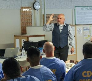 Robert Rodriguez, a licensed mental health therapist, discusses male behavior patterns as part of the Building Resilience inmate rehabilitation program. (Photo/California State Prison-Corcoran)