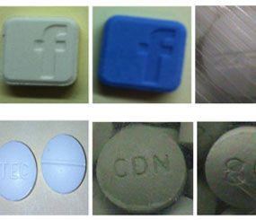 "The image above, distributed by Service de police de la Ville de Montréal (SPVM), shows seized drugs bearing copycat ""branding"" imprints such as Facebook in an effort to market the drug to young people. (PoliceOne Image)"