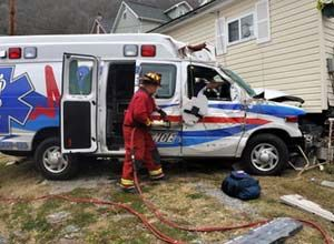 PhotoKyle Lovern/WDN A firefighter works at the scene of the ambulance crash Saturday.