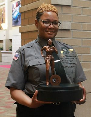 Michigan Corrections Officer of the Year Elwanda Ray with her customized award from Michigan Corrections Organization. (Photo/MCO)