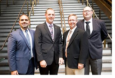 Amit Kapoor, President and CEO of First Line Technology (far left), Michael Corle, Product Manager DeconTect (left), Chris Hodge (right) and Tony Buhr (far right) of Naval Surface Warfare Center, Dahlgren Division accept the 2018 Excellence in Technology Transfer Award for Dahlgren Decon at the Federal Laboratory Consortium Awards Dinner in Philadelphia, Pennsylvania, April 25, 2018.