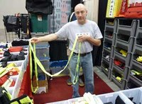 Rescue strap tightens down to size of firefighter