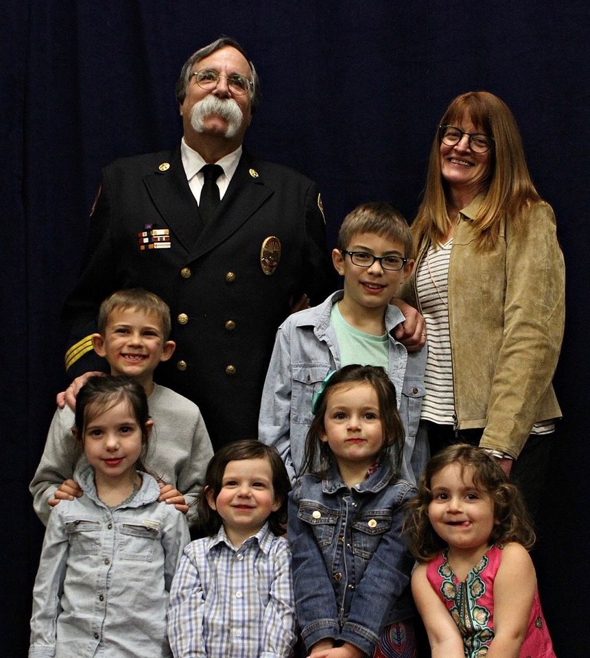 Chief Goldfeder brought his greatest accomplishment, his grandchildren, up on stage when he was honored at FDIC. (Photo courtesy of Billy Goldfeder)