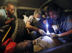 A teacher is treated in an ambulance after being freed from the rubble by rescuers in Port-au-Prince (AP Photo/Gerald Herbert)